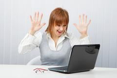 delighted girl looks at a monitor - stock photo