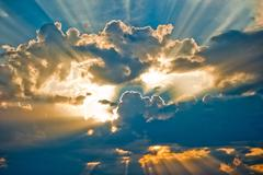 Beautiful heavenly landscape with the sun in the clouds. Stock Photos