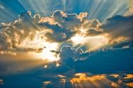 Stock Photo of Beautiful heavenly landscape with the sun in the clouds.