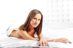 Sexy girl lying on the bed. Stock Photos