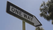 Stock Video Footage of Downtown Los Angeles, LA, One Way Street Road Sign Against Blue Sky, California