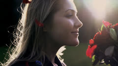 woman smelling on red roses shot in slow motion - stock footage