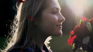 Stock Video Footage of woman smelling on red roses shot in slow motion