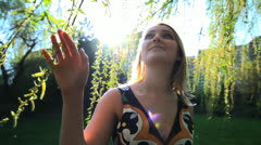 woman touching leaves of tree in slow motion - stock footage