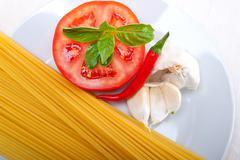 italian spaghetti pasta tomato ingredients - stock photo