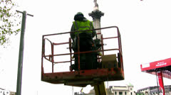 Workman inside cherry picker in London, England. Stock Footage
