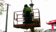 Stock Video Footage of Workman inside cherry picker in London, England.