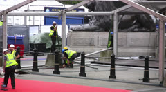Construction workers assembling a temporary structure in London, England Stock Footage