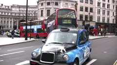 Red London buses and black cabs in Trafalgar square - stock footage