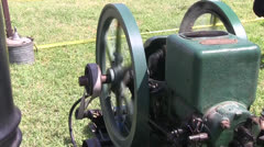 Antique, small engine used to pump water Stock Footage