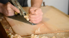 Carpenter or luthier planing wood Stock Footage