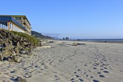 Sand foot-prints in cannon beach oregon. Stock Photos