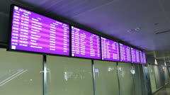 Information screens at airport lobby. Flight arrivals and departures screen Stock Footage
