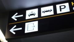 Airport directions sign: taxi, bus, parking, exit - stock footage