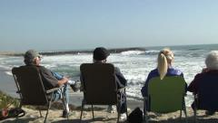Senior Citizens Relaxing Retired Beach Waves Sun Enjoy Life Ocean View Blue Sky Stock Footage