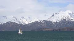 Sailboat on Kachemak Bay in Alaska past Kenai Mountains Stock Footage