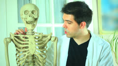 Discussing bones skeletal structure skeleton anatomy class Stock Footage