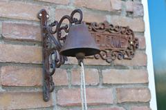 old door bell on a brick wall at home - stock photo