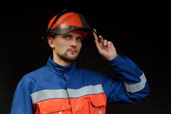 the worker in overalls - stock photo