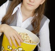 girl in a movie theater - stock photo