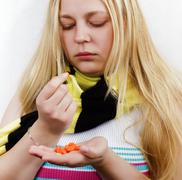 Girl with pills.treatment Stock Photos