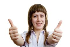 Young girl with two thumbs up Stock Photos