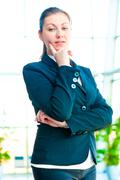 Portrait of successful businesswoman smiling on the background of a blurred - stock photo
