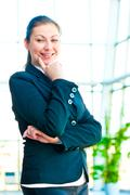 Portrait of smiling successful business people on the background of a blurred - stock photo
