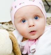 Baby with a soft toy Stock Photos