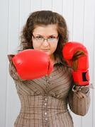 Business woman with boxing gloves Stock Photos