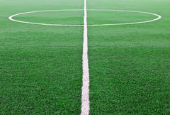 artificial grass soccer field - stock photo