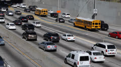Busy City Rush Hour Freeway Yellow School Buses Highway Los Angeles Downtown USA Stock Footage