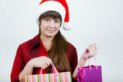 A girl in a christmas hat Stock Photos
