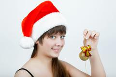 Girl in a christmas hat with christmas decorations Stock Photos