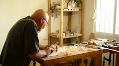 Luthier with a wood planer making a flamenco guitar Stock Footage