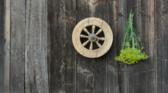 Hanging  medical herbs bunch on old wooden wall Stock Footage