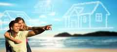 happy couple on the beach dreaming of a house. - stock photo