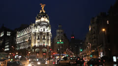 Gran Via, Madrid, Spain. Metropolis Building. Night traffic rush hour Stock Footage
