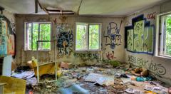 Adandoned trashed house with graffifi on walls Stock Photos