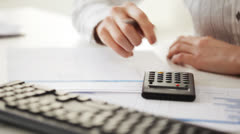 accountant making calculations and taking notes - stock footage