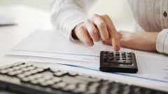 accountant making calculations and working with computer - stock footage