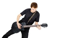 musician with a black electric guitar - stock photo