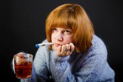 Sick girl with tea Stock Photos