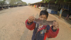 Cambodian kid and bat Stock Footage