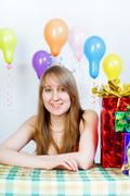 happy birthday. attractive young girl with gifts - stock photo