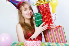 Happy birthday. attractive young girl with gifts Stock Photos