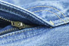 close up of the blue jeans zipper - stock photo
