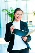Young happy business woman with an open folder in hand Stock Photos
