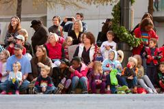 spectators look on in anticipation at atlanta christmas parade - stock photo