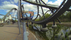 Theme Park Amusements -Scary Roller Coaster Ride - Through Billboard Stock Footage